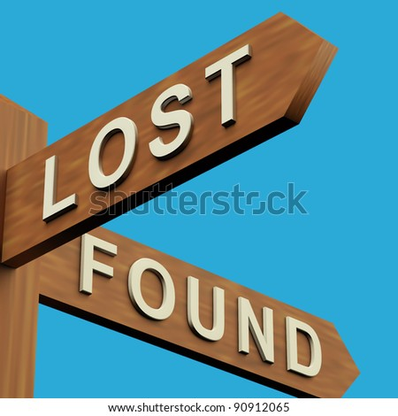 Lost Or Found Directions On A Wooden Signpost - stock photo
