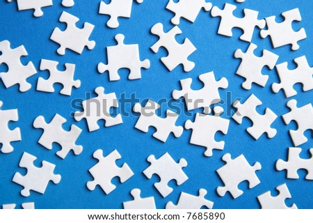 lost puzzle pieces on blue background