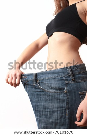 Lost weight - Woman showing weight loss - stock photo