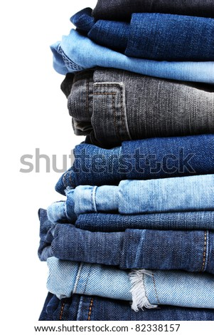 lot of blue jeans isolated on white