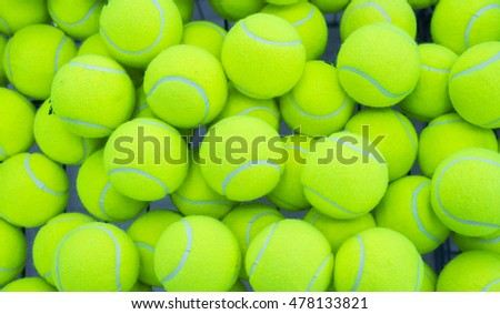 lot of bright yellow tennis balls as a background