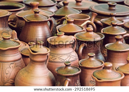 Lot of ceramics pots for sale taken closeup.Toned image. - stock photo