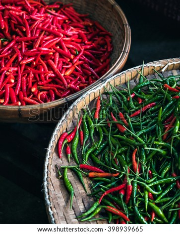 Lot of chili as a food background. Chili Pepper. Red and green Chili pepper background. Hot chili pepper on market. Pile of chili pepper. A lot of chili pepper. Chili pepper background. - stock photo