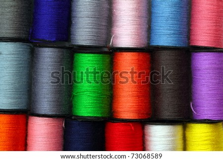 lot of colored thread spools - background - stock photo