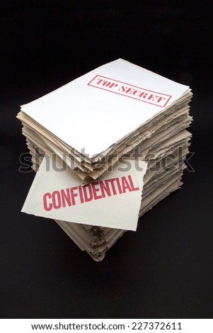 lot of confidential papers on black background - stock photo