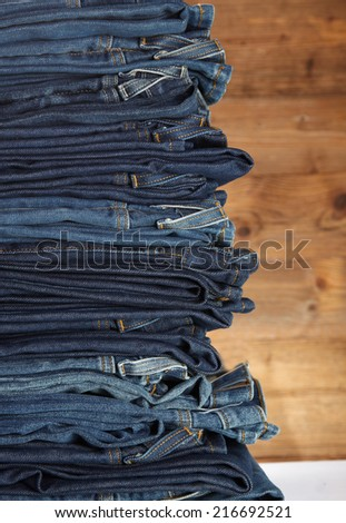 Lot of different blue jeans - stock photo
