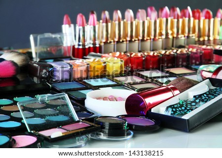 Lot of different cosmetics on green background - stock photo