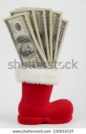 Lot of dollars in a Christmas sock on white background - stock photo
