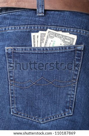 Lot of dollars in a pocket of jeans - stock photo
