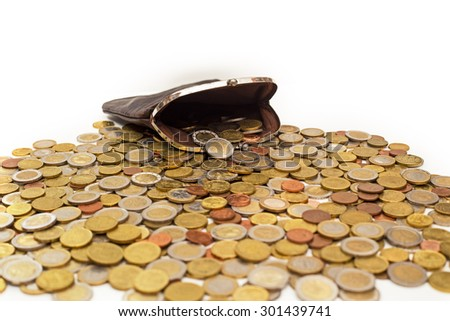 Lot of Euro coins on the background of an old leather wallet,   on white background - stock photo