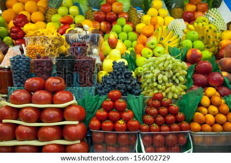 Lot of fresh fruits and vegetables for sale in the market - stock photo
