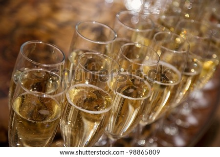 lot of glasses with champagne during on the party table - stock photo