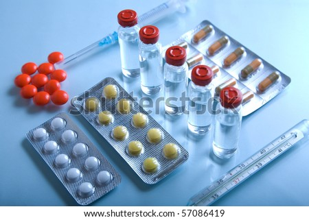 Lot of medicines, syringe, thermometer and pills - stock photo