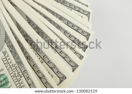 Lot of one hundred dollars isolated on grey background/Fan of dollars - stock photo