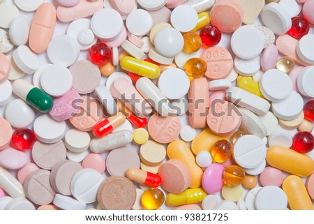 Lot of pills different shapes and colors as background - stock photo