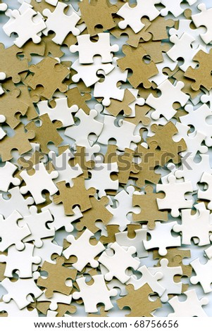 lot of puzzle pieces as a background - stock photo