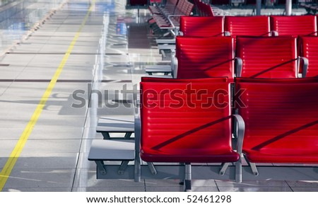 lot of red seats in the empty airport - stock photo