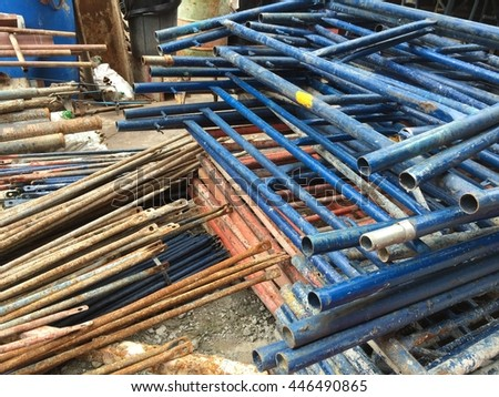Lot of scaffold in the construction site - stock photo