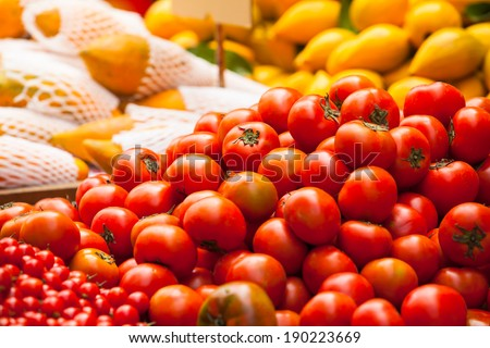 Lot of tomato vegetables and other fruits at a market stall/Tomato Market Sale - stock photo