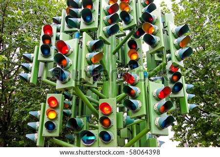 Lot of traffic lights at big pole - stock photo
