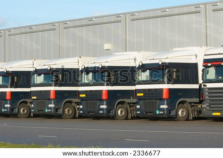 lot of trucks at loading dock - stock photo