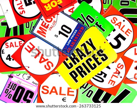 Lot of various discount labels on a heap.