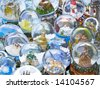 Lot of various snow globes on the table. - stock photo