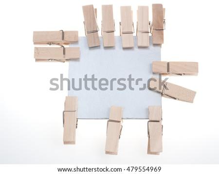 lot of wooden clips ,clamp, tweezers and silver paper on white and gray background