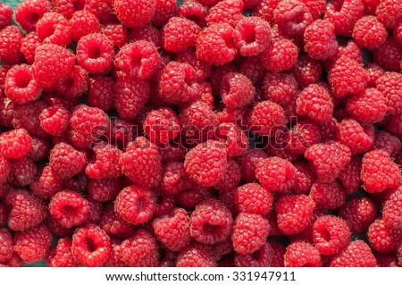Lot ripe red raspberries as background - stock photo