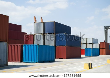 Lot's of cargo containers at the docks - stock photo
