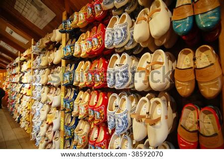 Lot's of shoes in souvenir shop. - stock photo