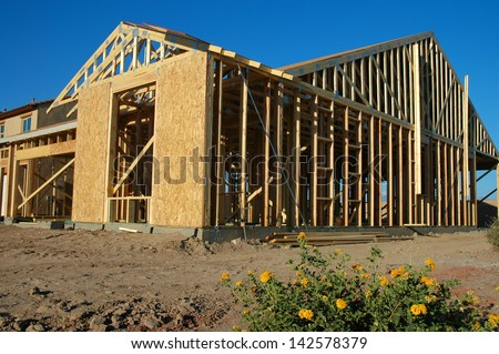 Lot with Home Under Construction - stock photo
