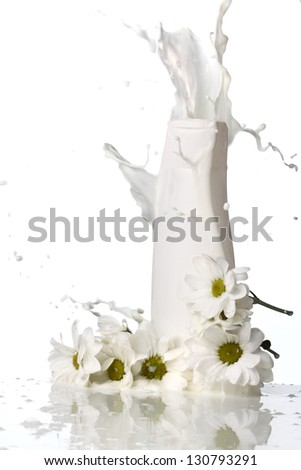 lotion with splashes and flowers - stock photo