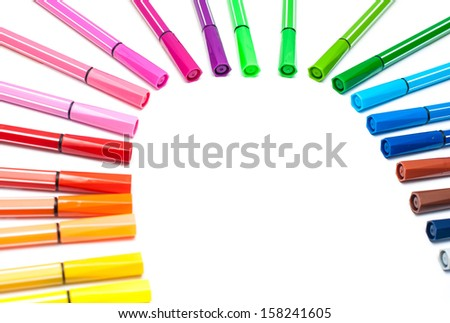 Lots of assorted colors marker pens on white background - stock photo