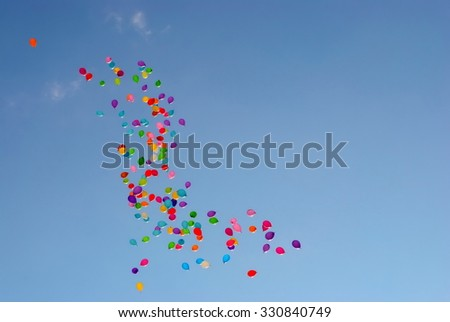 Lots of balloons flying in the sky - stock photo