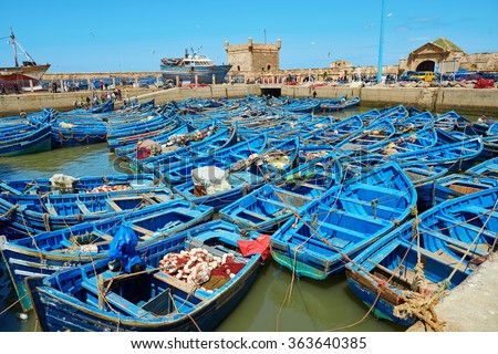 Lots of blue fishing boats in the port of Essaouira, Morocco - stock photo