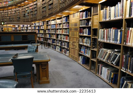 Lots of bookson shelves at the library. - stock photo