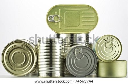 lots of cans against white background - stock photo