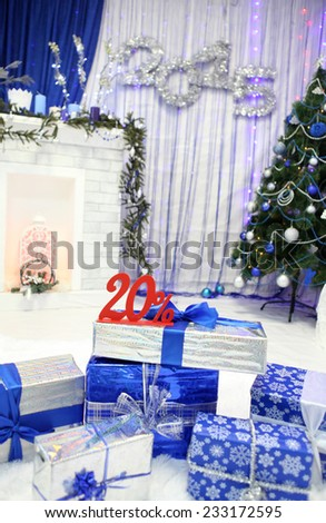 Lots of Christmas gifts and 20% is in a festive interior