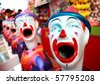 lots of clowns in a row at the fun fair - stock photo