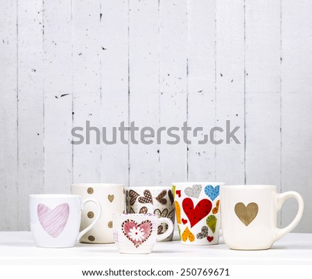 Lots of coffee in different cups with hearts. Copy space. - stock photo