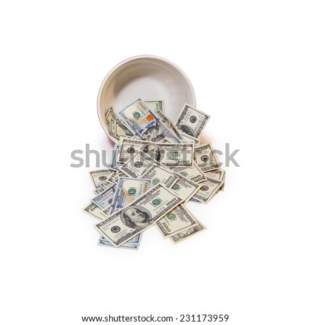 Lots Of Cold Cash Flowing From A Warm Colored Bowl Over A White Background. - stock photo