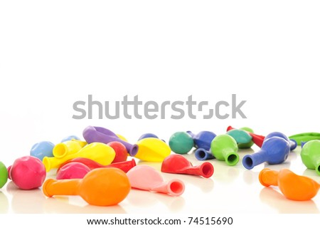Lots of colorful balloons laying on white background with copyspace