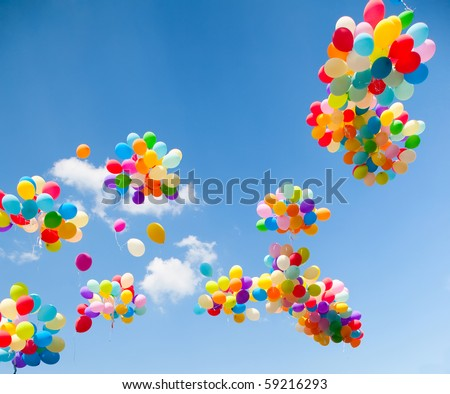 Lots of colorful balloons on the sky background - stock photo