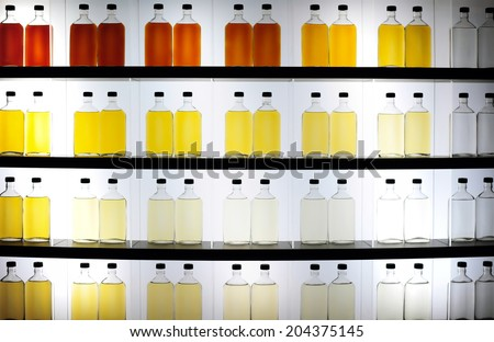 Lots of colorful bottles with alcohol - stock photo