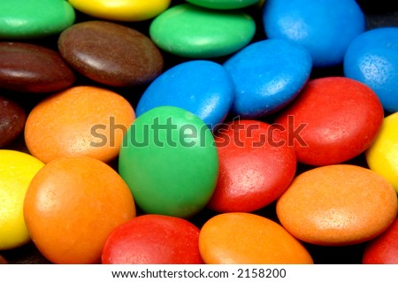 lots of colorful candies closeup from above - stock photo