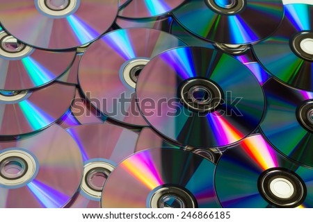 Lots of colorful discs on a pile for background use - stock photo