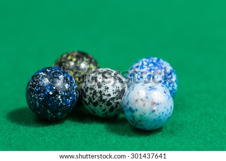 Lots of Colorful Marble Balls egg similar on Green background - stock photo