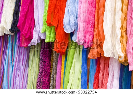 Lots of colorful shawls on a market place