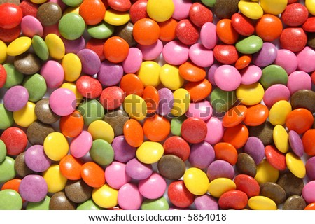 Lots of colorful smarties. - stock photo